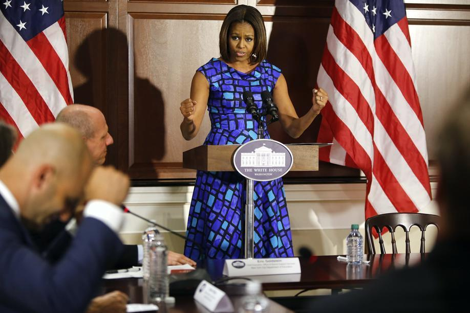 First Lady Michelle Obama pumped her first while speaking to school nutrition experts.